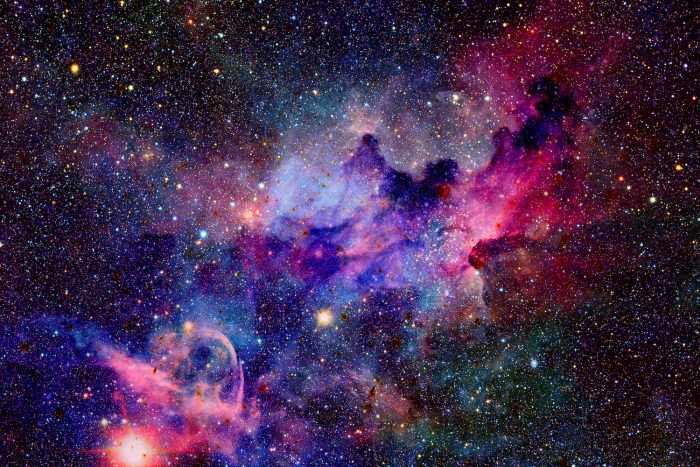 How does the expansion of the universe make outer space a vacuum